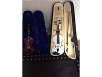 Two violins with bows and cases