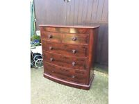 Beautiful flame mahogany bow front chest of drawers