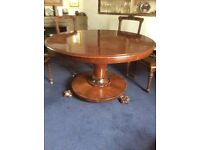 Round polished dining room table