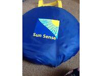 Sun sense pop up tent
