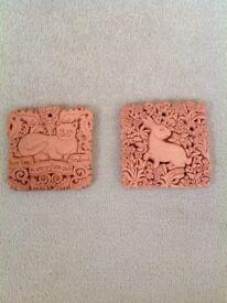 Terracotta wall plaques x2