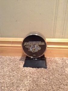 Nashville Predators NHL collectible puck in display