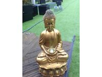 Golden Buddha water feature with lights and spinning ball