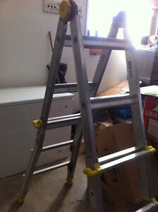 Adjustable folding ladder