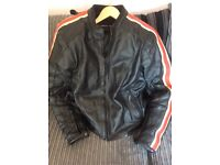 Woman's Black Lewis leather motorcycle jacket, size 16.