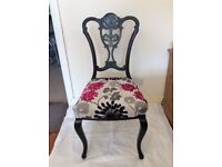 Antique carved back chair