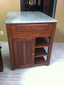 Kitchen Island with Granite top shelves and cupboards