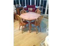 Round solid pine table and 4 chairs