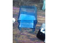 Two small blue tables