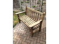 Wooden garden bench approximately 4 feet in width