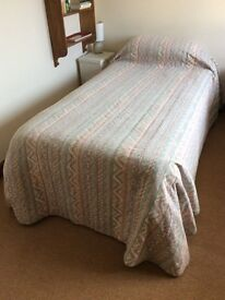 Two quilted single bedspreads