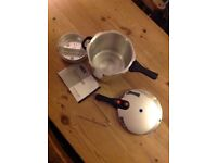 Prestige pressure cooker - Brand new item with instructions