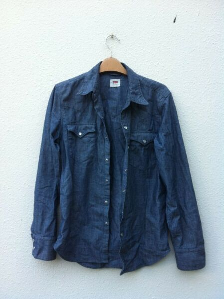 Authentic Levis denim shirt. Size XS. Seldom use and in good condition.
