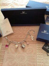 Genuine swaroski charm bracelet and charms