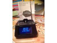Bluetooth speaker alarm clock docking station I phone.