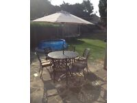 CAST ALUMINIUM GARDEN TABLE AND 6 CHAIRS HARTMAN