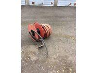 Fire hose with original reel.