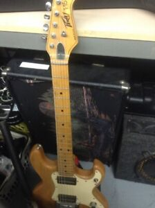 ***PEAVY ELECTRIC GUITAR AND AMP*** T 15 MODEL.