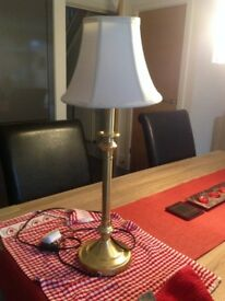 Smashing brass table lamp with cream shade