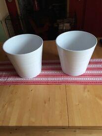 2 identical white ceramic indoor plant pots