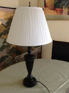 Table lamp with pleated shade, black base