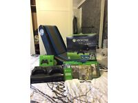 X box one 500 gb and game chair