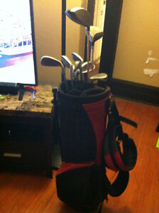 Left Hand golf clubs and red & black bag