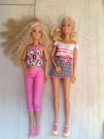 Double Barbie dressed dolls