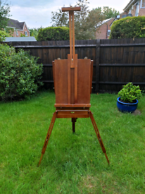 Artists easel with oil paints / brushes palette etc