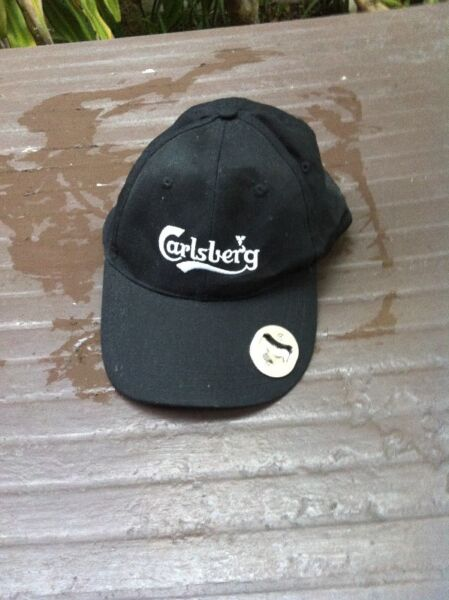 Carlsberg cap with bottle opener. Brand new and never used before.