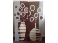 2 canvas prints of flowers and vases