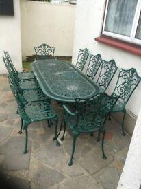 CAST ALUMINIUM GARDEN TABLE AND 10 CHAIRS