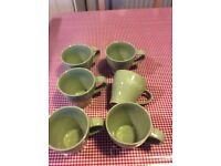 6 green coffee cups