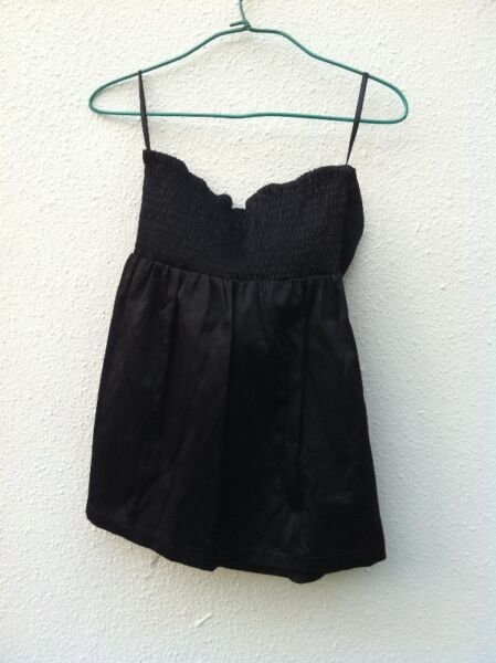 Brand new Little Match Girl Black Dress Size L. Never used before.