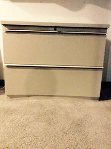 "Two drawer filing cabinet 48"" wide 13"" deep 14"" high."