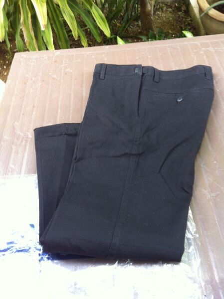 New and not yet used adjustable waist Men's pants.