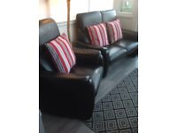 Real leather black very good condition 2 seater sofa and chair