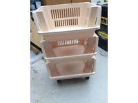 Set of 3 cream baskets on wheels