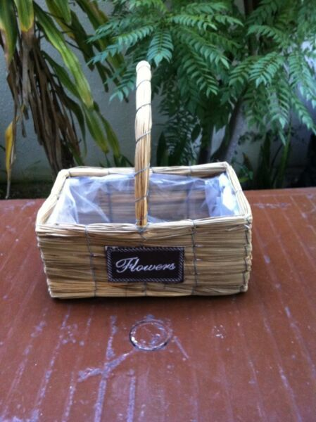 Reed flower basket.  Dimension 30 x 20 x 13cm.  In good condition.