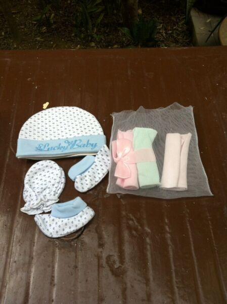 Baby socks, gloves and cap.   New and never been used.