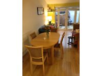 Extending Dining Table and 6 upholstered chairs