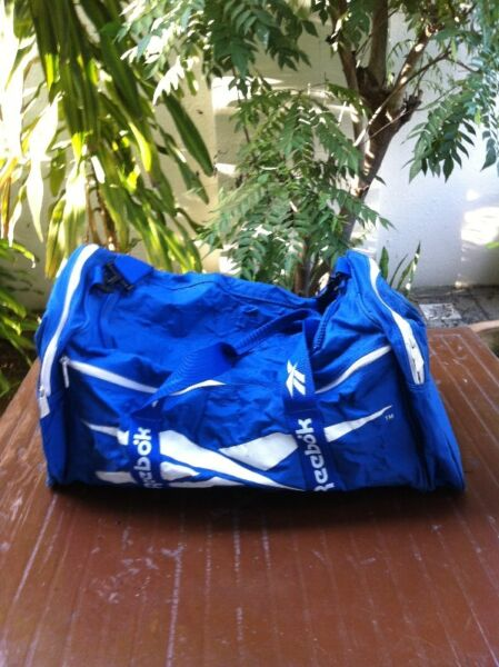 Genuine Reebok blue bag.  Dimension is 60 x 35 x 32cm in height. In good condition.
