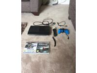 Ps3 sony playstation 3 super slim + 2 GAMES and PS MOVE pad