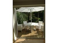 Fabulous white garden set & 2 large parasols + 1 stand £225 the lot ovno