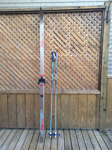 2 pairs of cross country skis and poles, $20.00