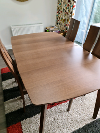 Walnut extending dinning table with 4 chairs