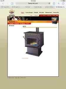 GIT GRAVITY FEED OIL STOVE ! LOOKS LIKE WOOD STOVE 200. fIRM