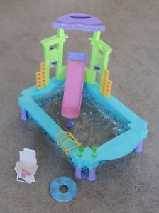 Barbie items–swimming pool, office, stores, bike, dolls, car,etc