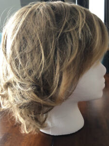 Wig, never worn, and care kit for sale