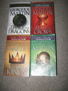 4 George R.R. Martin paperbacks-very good condition-$5 each